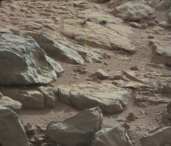 Green lines point to a shiny protuberance on rock imaged by the Curiosity rover on Mars. Credit: NASA/JPL/Malin Space Science Systems. Image processing 2di7 &amp; titanio44 on Flickr. 