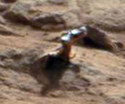 A closeup of the shiny protuberance. Credit: NASA/JPL/Malin Space Science Systems. Image editing by  2di7 &amp; titanio44 on Flickr.