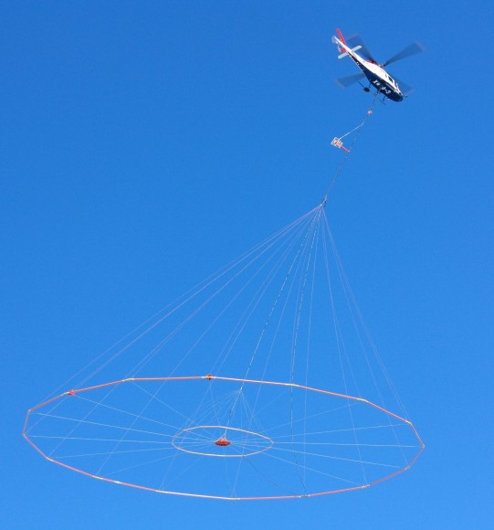 Koala helicopter towing Versatile Domain Electromagnetic Surveying equipment. (Credit: USGS).